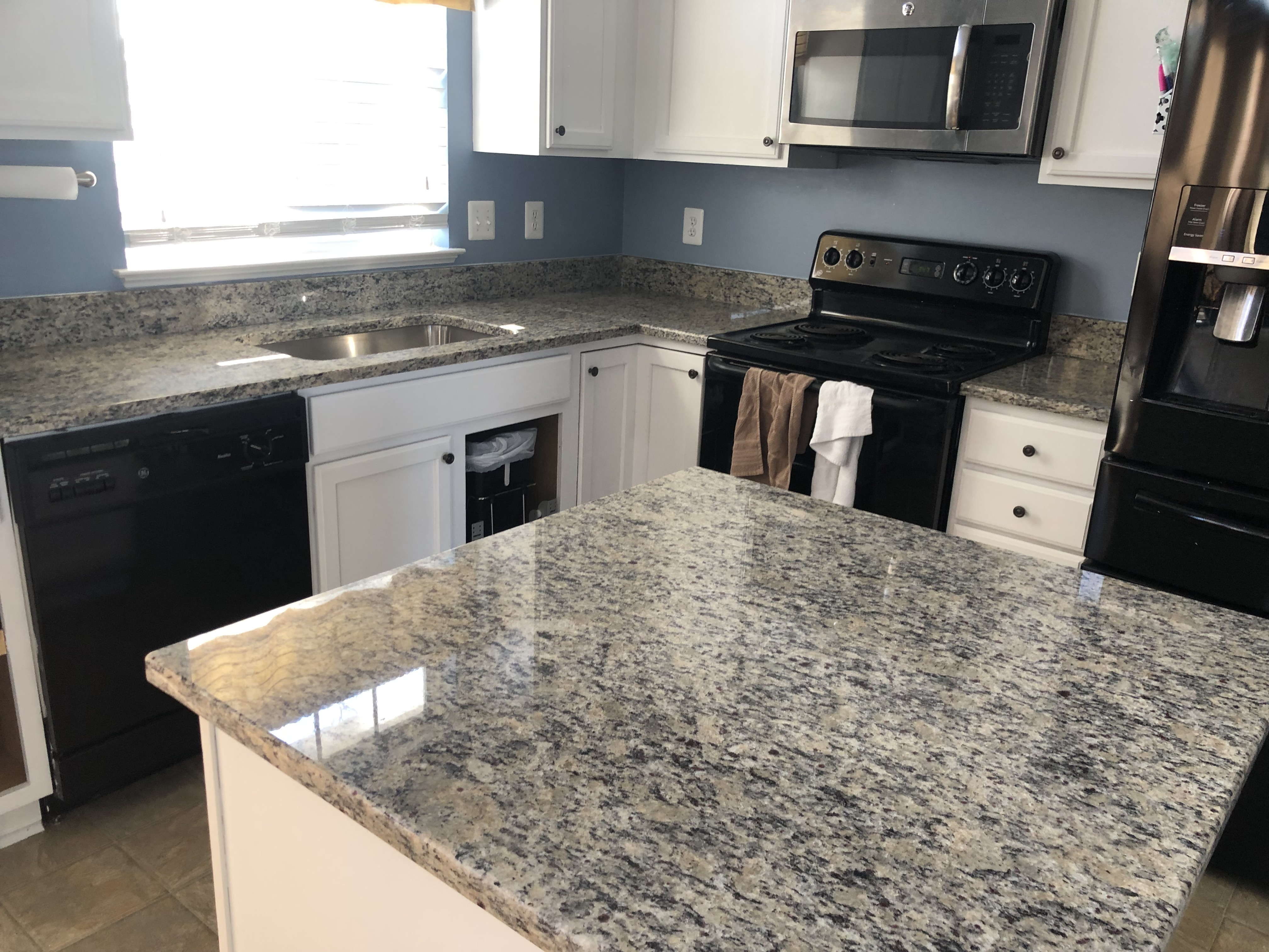 Santa Cecilia Light Granite System Kitchen Countertops